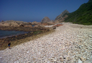 One of the many rocky beaches on the long coastal hike